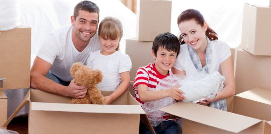 family-moving-home-with-boxes-around-l_02
